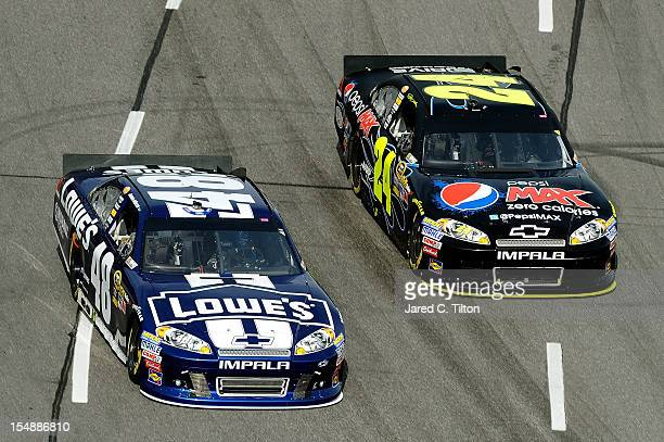 Jimmie Johnson driver of the Lowe's Chevrolet and Jeff Gordon driver of the Pepsi Max Chevrolet race during the NASCAR Sprint Cup Series Tums Fast...