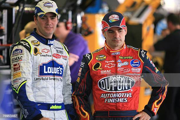 Jimmie Johnson driver of the Lowe's Chevrolet and Jeff Gordon driver of the DuPont Chevrolet stand in the garage during practice for the NASCAR...