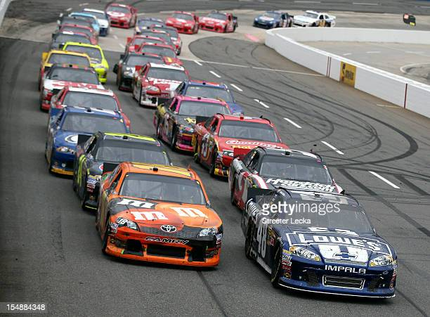 Jimmie Johnson driver of the Lowe's Chevrolet and Kyle Busch driver of the MM's Halloween Toyota lead a group of cars during the NASCAR Sprint Cup...