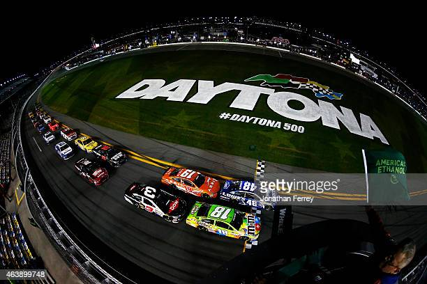 Jimmie Johnson driver of the Lowe's Chevrolet and Kyle Busch driver of the MM's Crispy Toyota lead the field to the green flag for the running of the...