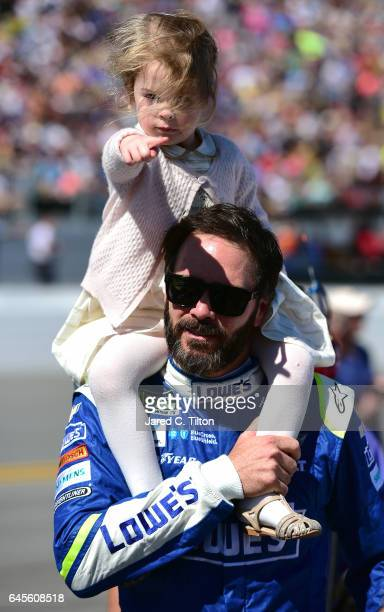 Jimmie Johnson driver of the Lowe's Chevrolet and walks with his daughter Lydia Norriss before the 59th Annual DAYTONA 500 at Daytona International...
