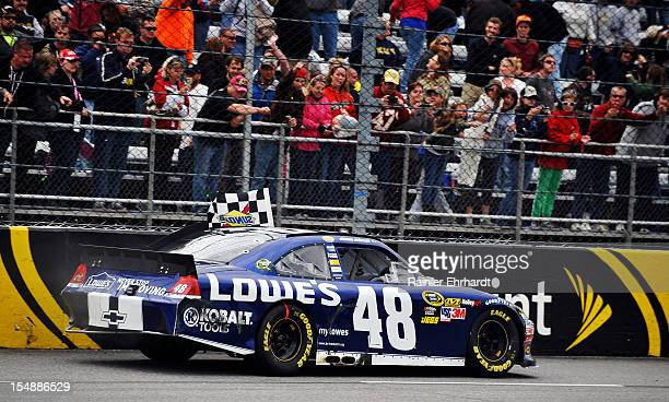 Jimmie Johnson driver of the Lowe's Chevrolet celebrates after winning the NASCAR Sprint Cup Series Tums Fast Relief 500 at Martinsville Speedway on...