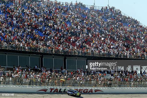 Jimmie Johnson driver of the Lowe's Chevrolet celebrates after winning the NASCAR Nextel Cup Series Aaron's 499 at the Talladega Superspeedway on May...