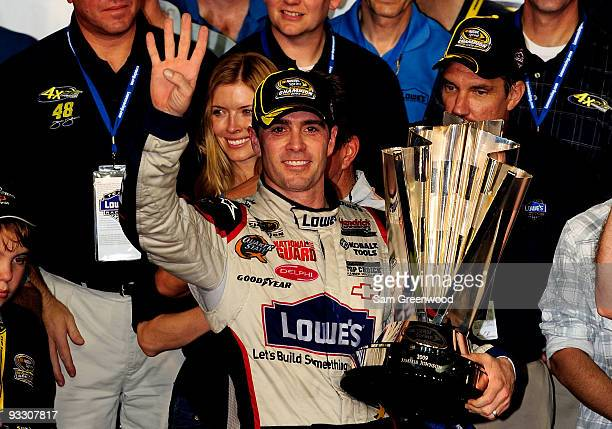 Jimmie Johnson driver of the Lowe's Chevrolet celebrates after winning the NASCAR Sprint Cup Series Championship after finishing in fifth place in...