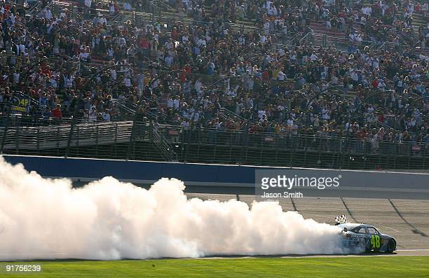 Jimmie Johnson driver of the Lowe's Chevrolet celebrates by performing a burnout after winning the NASCAR Sprint Cup Series Pepsi 500 at Auto Club...