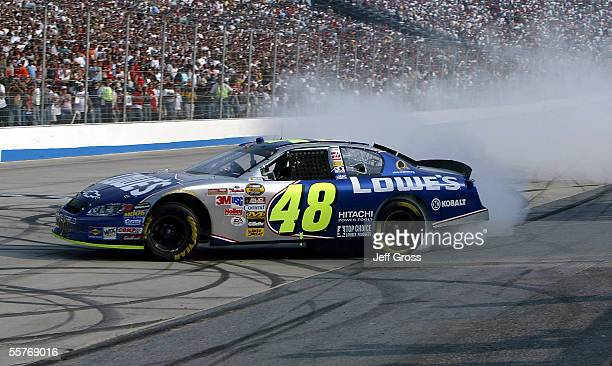 Jimmie Johnson driver of the Lowe's Chevrolet celebrates by spinning his tires after winning the NASCAR Nextel Cup Series MBNA NASCAR RacePoints 400...