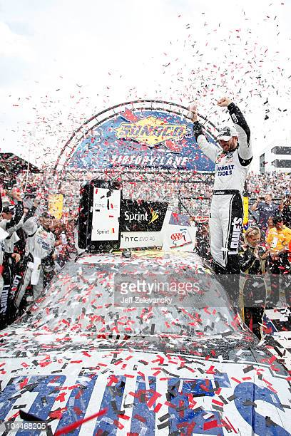 Jimmie Johnson driver of the Lowe's Chevrolet celebrates in Victory Lane after winning the NASCAR Sprint Cup Series AAA 400 at Dover International...