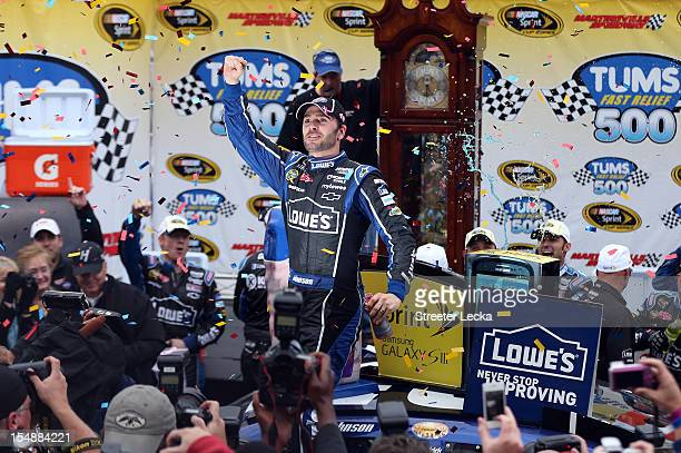 Jimmie Johnson driver of the Lowe's Chevrolet celebrates in Victory Lane after winning the NASCAR Sprint Cup Series Tums Fast Relief 500 at...