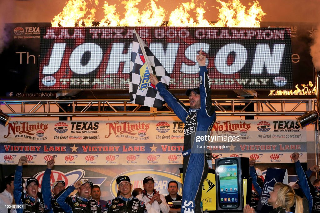 Jimmie Johnson, driver of the #48 Lowe's Chevrolet, celebrates in Victory Lane after winning the NASCAR Sprint Cup Series AAA Texas 500 at Texas Motor Speedway on November 4, 2012 in Fort Worth, Texas.