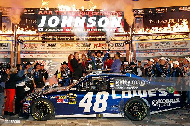 Jimmie Johnson driver of the Lowe's Chevrolet celebrates in Victory Lane by firing the commemorative Turnbull pistols as Texas Motor Speedway...