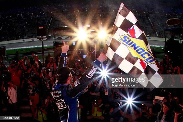 Jimmie Johnson driver of the Lowe's Chevrolet celebrates in Victory Lane after winning the NASCAR Sprint Cup Series AAA Texas 500 at Texas Motor...