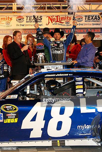 Jimmie Johnson driver of the Lowe's Chevrolet celebrates in Victory Lane by firing the commemorative Turnbull pistols after winning the NASCAR Sprint...