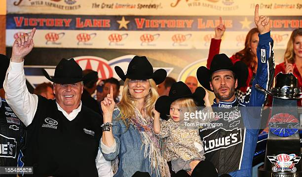 Jimmie Johnson driver of the Lowe's Chevrolet celebrates in Victory Lane with daughter Genevieve Marie wife Chandra and team owner Rick Hendrick...