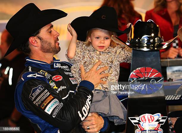 Jimmie Johnson driver of the Lowe's Chevrolet celebrates in Victory Lane with daughter Genevieve Marie after winning the NASCAR Sprint Cup Series AAA...