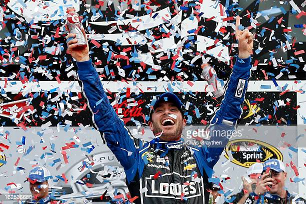 Jimmie Johnson driver of the Lowe's Chevrolet celebrates in victory lane after winning the NASCAR Sprint Cup Series Daytona 500 at Daytona...