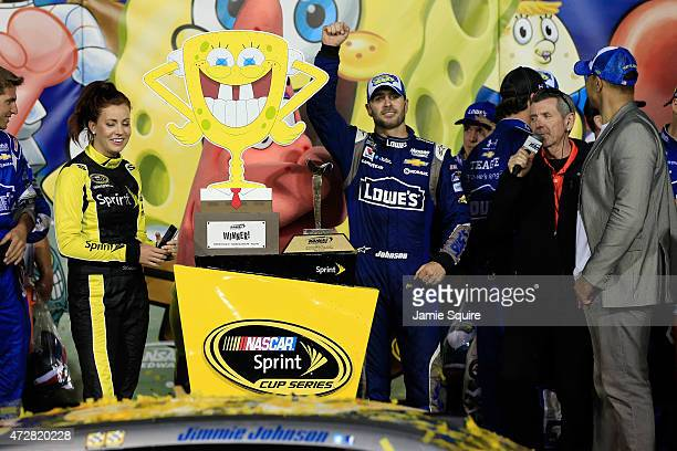 Jimmie Johnson, driver of the Lowe's Chevrolet, celebrates in Victory Lane after winning the NASCAR Sprint Cup Series SpongeBob SquarePants 400 at...