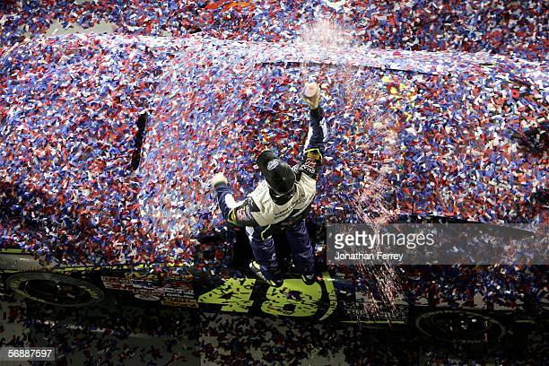 Jimmie Johnson driver of the Lowe's Chevrolet celebrates in victory lane after winning the NASCAR Nextel Cup Daytona 500 on February 19 2006 at...
