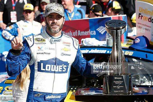 Jimmie Johnson driver of the Lowe's Chevrolet celebrates in victory lane after winning the NASCAR Sprint Cup Series Bank of America 500 at Charlotte...