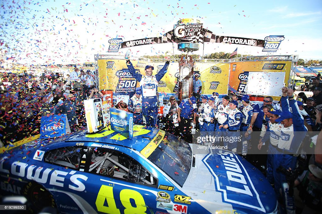 Jimmie Johnson, driver of the #48 Lowe's Chevrolet, celebrates in Victory Lane after winning the NASCAR Sprint Cup Series Goody's Fast Relief 500 at Martinsville Speedway on October 30, 2016 in Martinsville, Virginia.