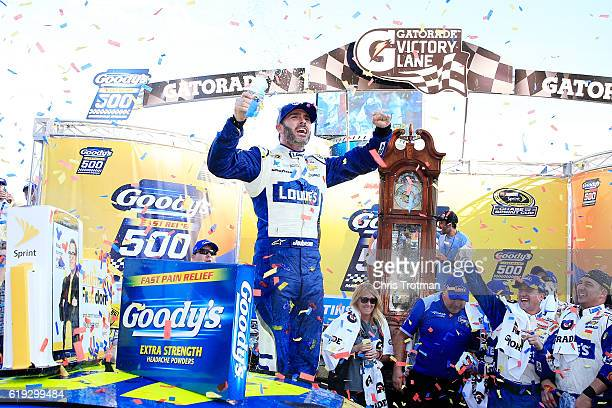 Jimmie Johnson, driver of the Lowe's Chevrolet, celebrates in Victory Lane after winning the NASCAR Sprint Cup Series Goody's Fast Relief 500 at...