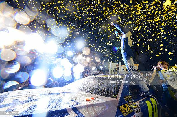 Jimmie Johnson driver of the Lowe's Chevrolet celebrates in Victory Lane after winning the NASCAR Sprint Cup Series Ford EcoBoost 400 and the 2016...