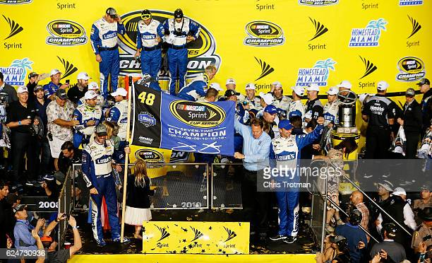 Jimmie Johnson driver of the Lowe's Chevrolet celebrates in Victory Lane with his team after winning the NASCAR Sprint Cup Series Ford EcoBoost 400...
