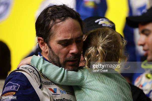 Jimmie Johnson driver of the Lowe's Chevrolet celebrates in Victory Lane with his daughter Lydia Norriss after winning the NASCAR Sprint Cup Series...