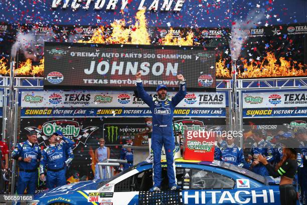 Jimmie Johnson driver of the Lowe's Chevrolet celebrates in Victory Lane after winning the Monster Energy NASCAR Cup Series O'Reilly Auto Parts 500...