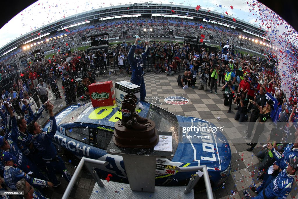 Jimmie Johnson, driver of the #48 Lowe's Chevrolet, celebrates in Victory Lane after winning the Monster Energy NASCAR Cup Series O'Reilly Auto Parts 500 at Texas Motor Speedway on April 9, 2017 in Fort Worth, Texas.