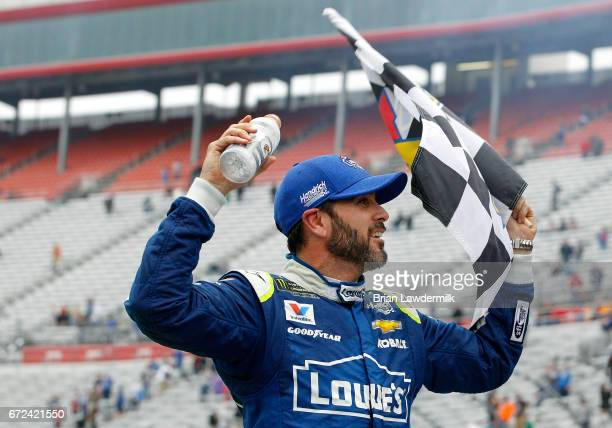 Jimmie Johnson driver of the Lowe's Chevrolet celebrates in Victory Lane after winning the Monster Energy NASCAR Cup Series Food City 500 at Bristol...