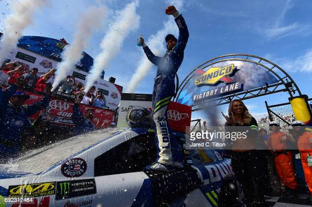 Jimmie Johnson, driver of the Lowe's Chevrolet, celebrates in Victory Lane after winning the Monster Energy NASCAR Cup Series AAA 400 Drive for...