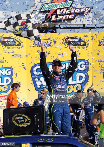 Jimmie Johnson, driver of the Lowe's Chevrolet, celebrates in victory lane after winning the NASCAR Sprint Cup Series Camping World RV 400 at Kansas...