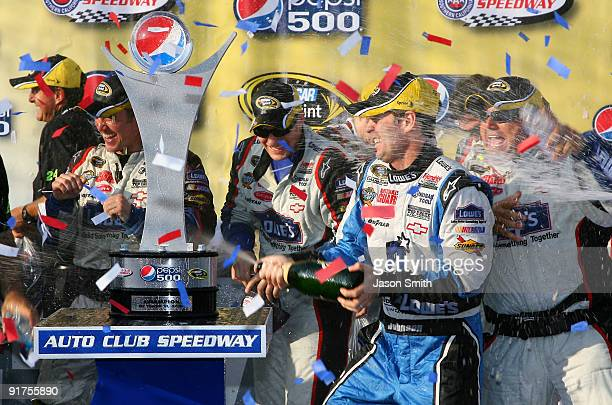 Jimmie Johnson driver of the Lowe's Chevrolet celebrates in victory lane after winning the NASCAR Sprint Cup Series Pepsi 500 at Auto Club Speedway...