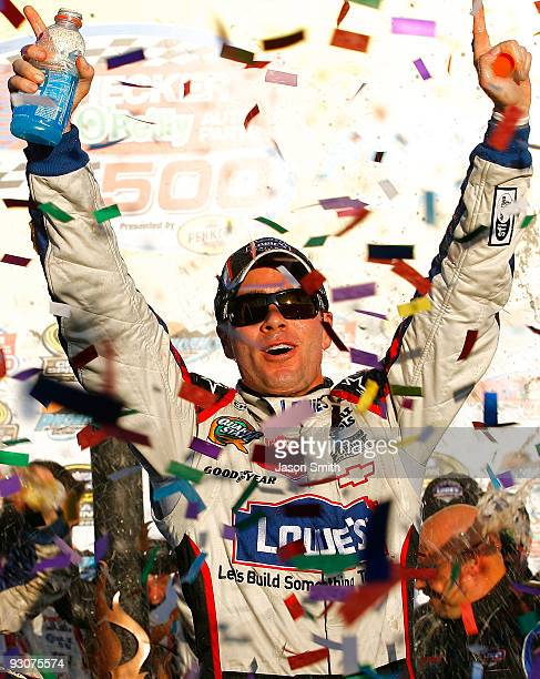 Jimmie Johnson, driver of the Lowe's Chevrolet, celebrates in victory lane after winning the NASCAR Sprint Cup Series Checker O'Reilly Auto Parts 500...