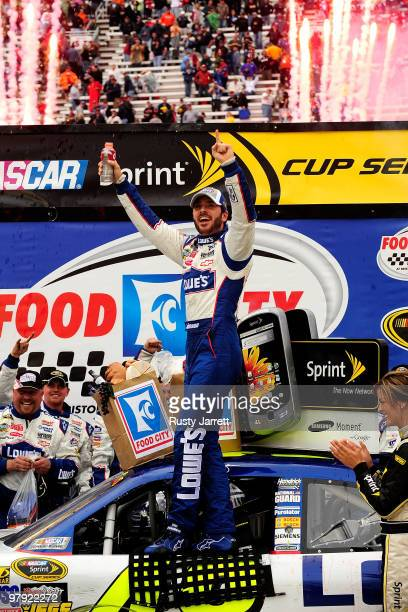 Jimmie Johnson driver of the Lowe's Chevrolet celebrates in Victory Lane after winning the NASCAR Sprint Cup Series Food City 500 at Bristol Motor...