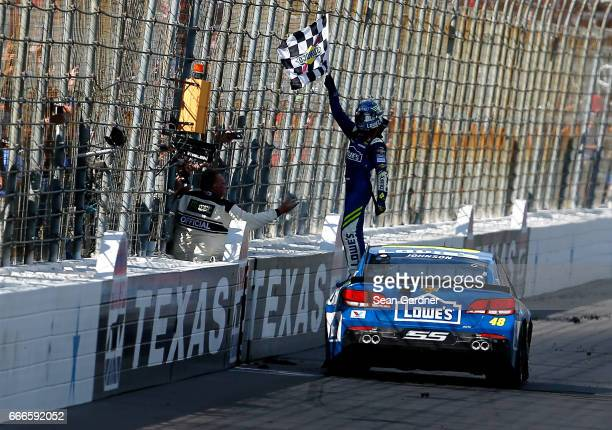 Jimmie Johnson driver of the Lowe's Chevrolet celebrates winning the Monster Energy NASCAR Cup Series O'Reilly Auto Parts 500 at Texas Motor Speedway...