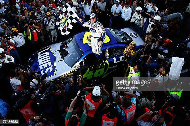 Jimmie Johnson driver of the Lowe's Chevrolet celebrates winning the NASCAR Nextel Cup Series Subway 500 at Martinsville Speedway on October 21 2007...