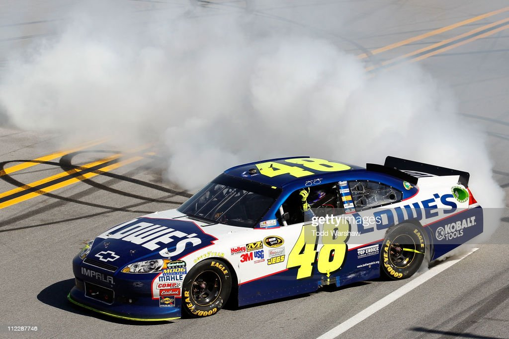 Jimmie Johnson, driver of the #48 Lowe's Chevrolet, celebrates with a burnout after winning the NASCAR Sprint Cup Series Aaron's 499 at Talladega Superspeedway on April 17, 2011 in Talladega, Alabama.
