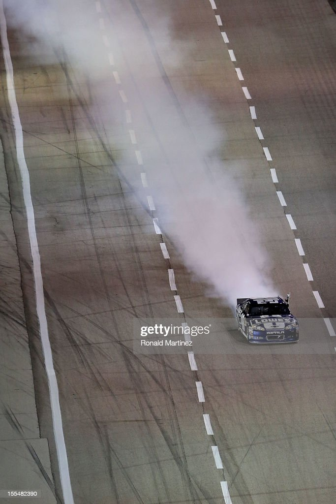 Jimmie Johnson, driver of the #48 Lowe's Chevrolet, celebrates with a burnout after winning the NASCAR Sprint Cup Series AAA Texas 500 at Texas Motor Speedway on November 4, 2012 in Fort Worth, Texas.