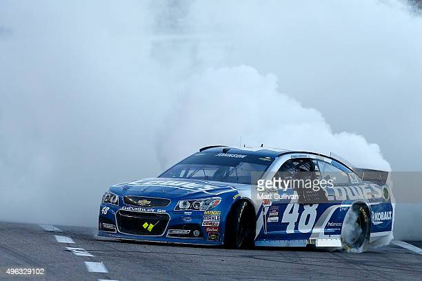 Jimmie Johnson driver of the Lowe's Chevrolet celebrates with a burnout after winning the NASCAR Sprint Cup Series AAA Texas 500 at Texas Motor...