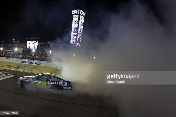 Jimmie Johnson driver of the Lowe's Chevrolet celebrates with a burnout after winning the NASCAR Sprint Cup Series Ford EcoBoost 400 and the 2016...