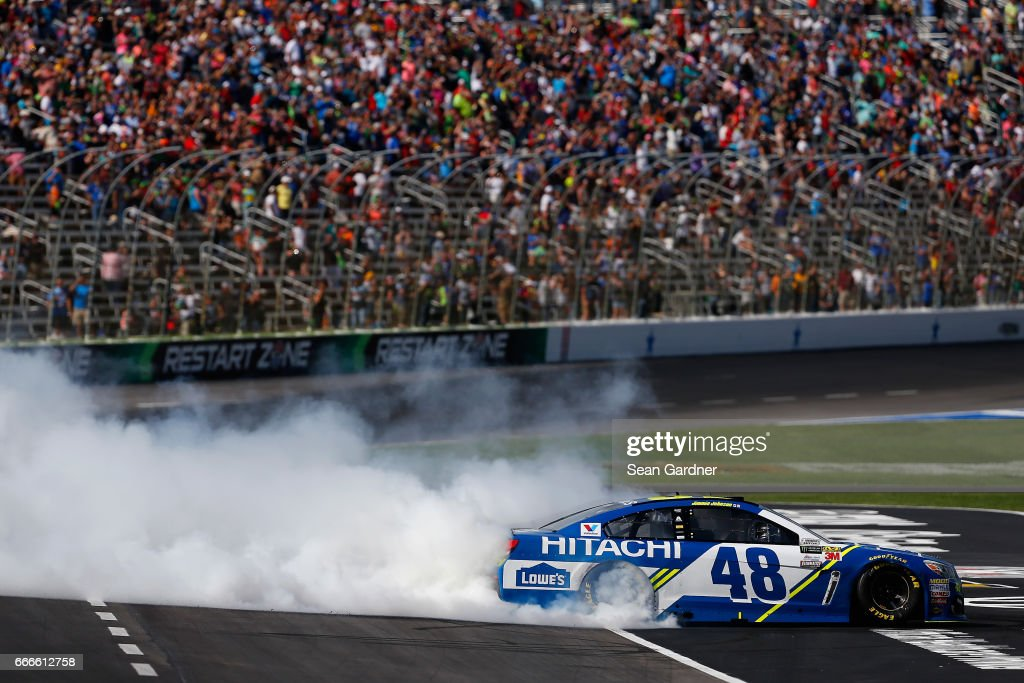 Jimmie Johnson, driver of the #48 Lowe's Chevrolet, celebrates with a burnout after winning the Monster Energy NASCAR Cup Series O'Reilly Auto Parts 500 at Texas Motor Speedway on April 9, 2017 in Fort Worth, Texas.