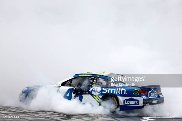 Jimmie Johnson, driver of the Lowe's Chevrolet, celebrates with a burnout after winning the Monster Energy NASCAR Cup Series Food City 500 at Bristol...