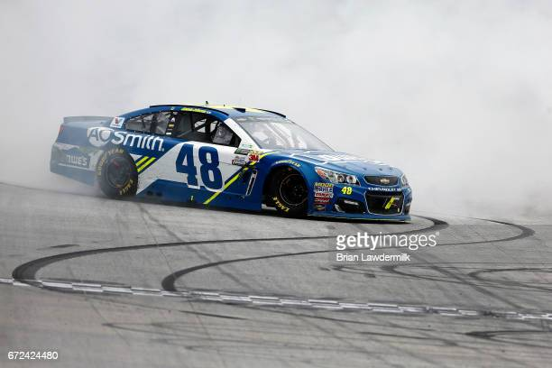 Jimmie Johnson driver of the Lowe's Chevrolet celebrates with a burnout after winning the Monster Energy NASCAR Cup Series Food City 500 at Bristol...