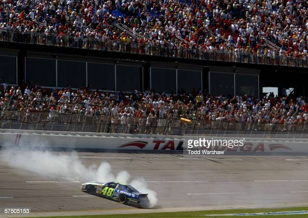 Jimmie Johnson driver of the Lowe's Chevrolet celebrates with a burn out after winning the NASCAR Nextel Cup Series Aaron's 499 at the Talladega...
