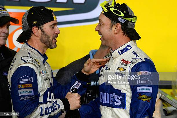 Jimmie Johnson driver of the Lowe's Chevrolet celebrates with crew chief Chad Knaus in Victory Lane after winning the NASCAR Sprint Cup Series Ford...