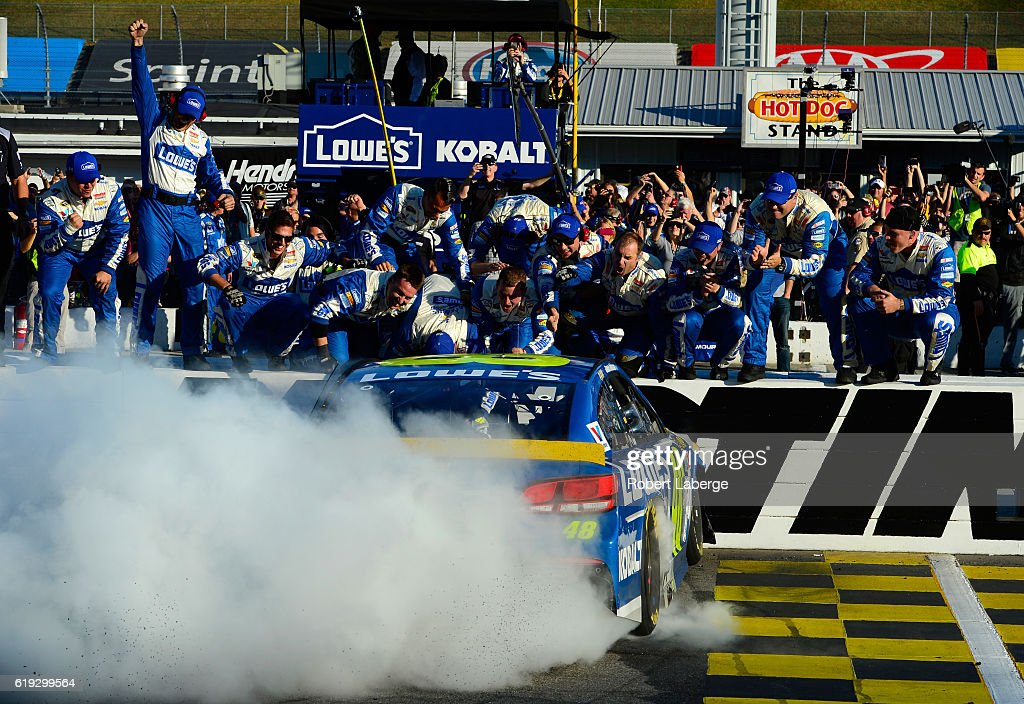 Jimmie Johnson, driver of the #48 Lowe's Chevrolet, celebrates with his team and a burnout after winning the NASCAR Sprint Cup Series Goody's Fast Relief 500 at Martinsville Speedway on October 30, 2016 in Martinsville, Virginia.