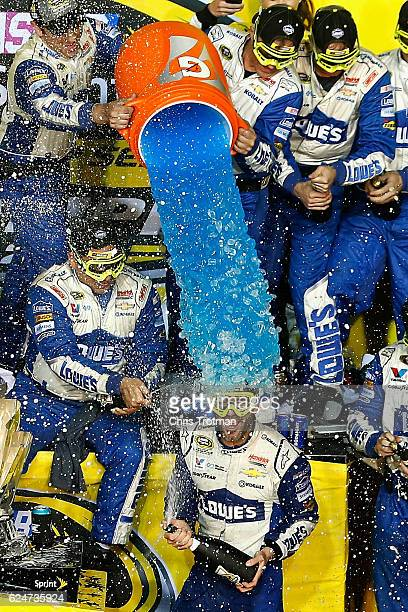 Jimmie Johnson, driver of the Lowe's Chevrolet, celebrates with his team in Victory Lane after winning the NASCAR Sprint Cup Series Ford EcoBoost 400...
