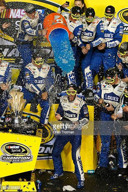 Jimmie Johnson driver of the Lowe's Chevrolet celebrates with his team in Victory Lane after winning the NASCAR Sprint Cup Series Ford EcoBoost 400...