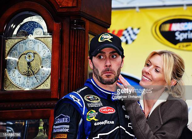 Jimmie Johnson driver of the Lowe's Chevrolet celebrates with his wife Chandra in Victory Lane after winning the NASCAR Sprint Cup Series Tums Fast...